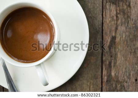 Coffee cup on the wood texture.