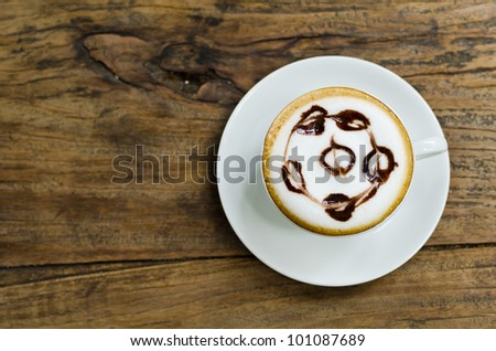 Coffee cup on the wood texture background.