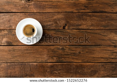 Coffee cup on vintage wooden table with copyspace. Top view Foto stock ©