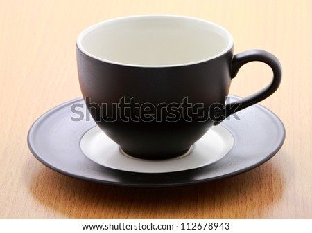 Coffee cup on wood background