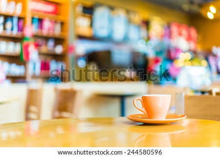 Coffee cup on wooden table in coffee shop - vintage effect style pictures