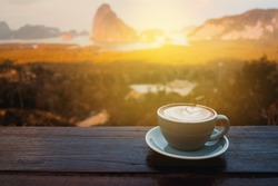 Coffee cup on wooden table in the morning, Coffee in the nature view.