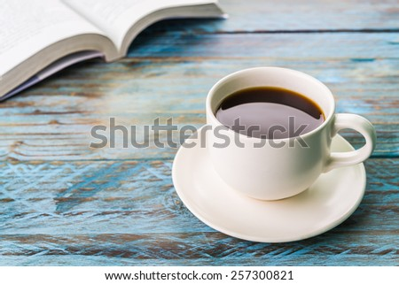 Coffee cup on wooden table - Vintage effect style pictures