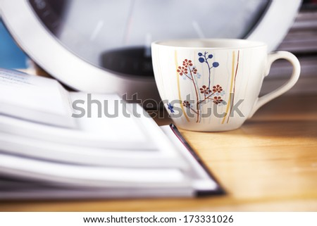 coffee cup on working desk close up