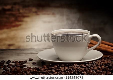 Coffee cup over grunge wooden background - stock photo