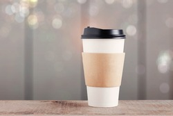 Coffee cup paper with wooden background.