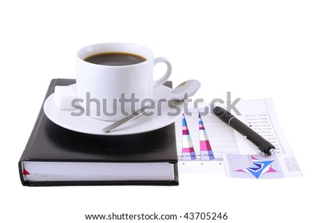 Coffee cup, pen,standing on the personal organizer-  with   financial  diagrams  under organizer. Isolated
