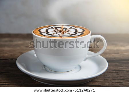 Coffee cup placed on a piece of old wood #511248271