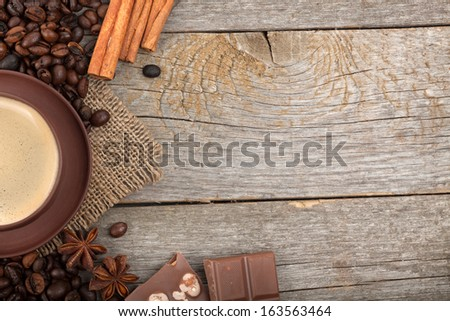 Coffee cup, spices and chocolate on wooden table texture with copy space. View from above #163563464