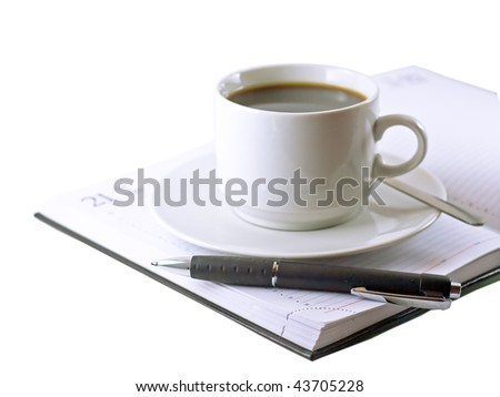 Coffee cup,  standing on the opened daily organizer . Fragment. Isolated - stock photo