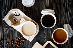 coffee cup take away at wooden background top view