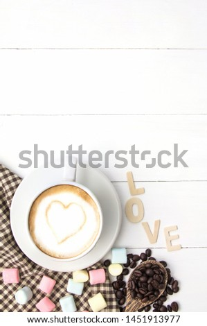 Coffee cup white hart latte art and dessert of marshmallow, Roasted coffee beans on white wooden,Copy space for you text.vertical #1451913977
