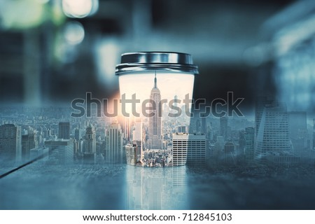 Coffee cup with abstract New York city skyline. Morning concept. Double exposure