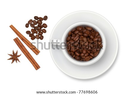 Coffee cup with beans, anise and cinnamon. Above view. Isolated on white background