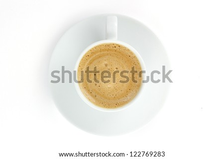 Coffee cup with foam and cream on a plate isolated on white background