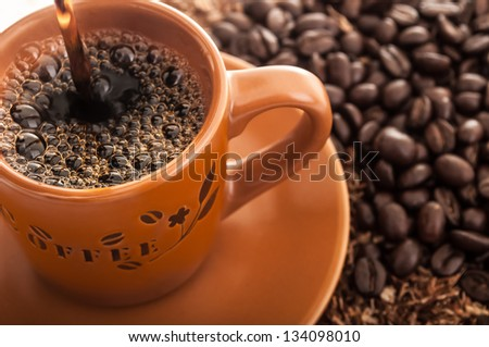 Coffee cup with fresh coffee beans