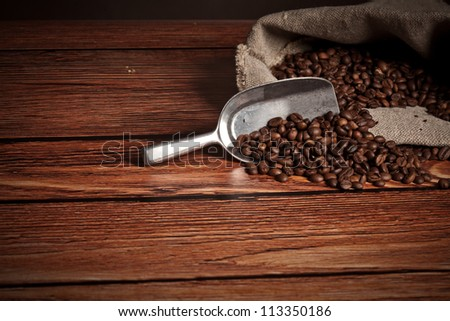 Coffee cup with Heart of coffee beans on the wooden table