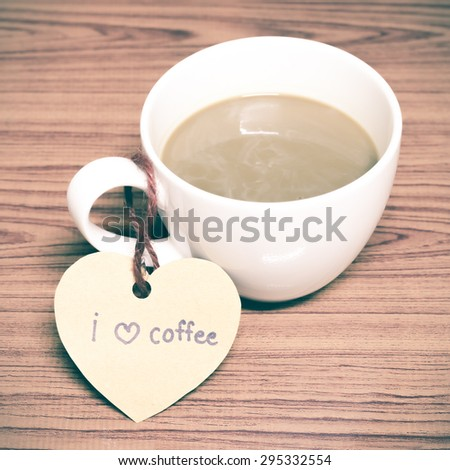 coffee cup with heart tag write I love coffee word on wood background vintage style