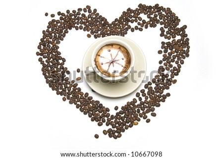 Coffee cup with in hearth, beans on white table