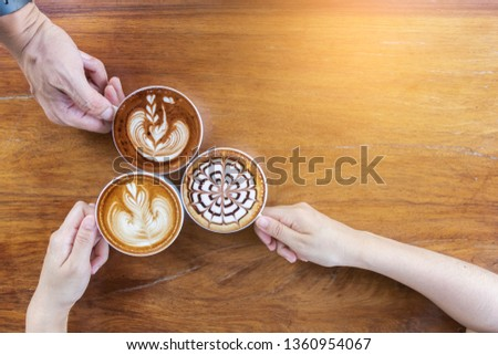 Photo of  Coffee cup with latte art foam on wood table in coffee shop with copy space.Coffee is one of the most popular beverages.Improve Energy Levels and Burn Fat