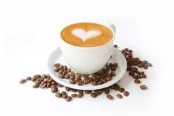 Coffee cup with latte art heart shape and beans isolated on a white background.