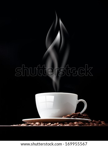 Coffee cup with smoke and grain against black wall.