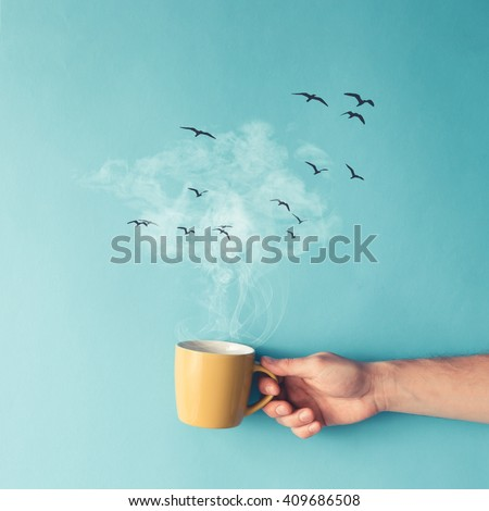 Shutterstock Coffee cup with steam, clouds and birds. Coffee concept. Flat lay.