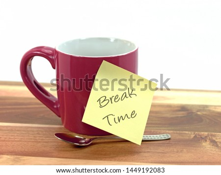 """Coffee cup with sticky note saying break,""""Break Time"""""""