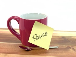 Coffee cup with sticky note saying break,