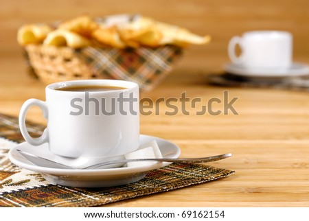 Coffee cup with sugar and cookies on the wooden table - stock photo