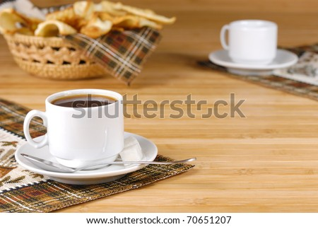 Coffee cup with sugar and cookies on the wooden table