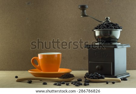 coffee cup with wooden manul coffee grinder