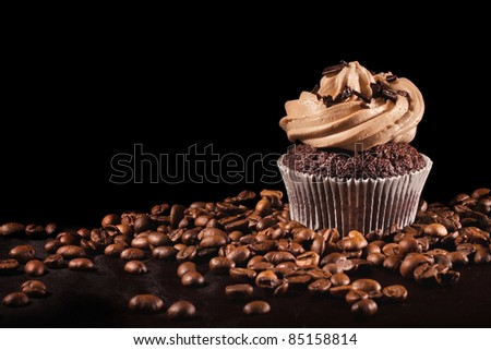 Coffee cupcake & coffee beans on black background