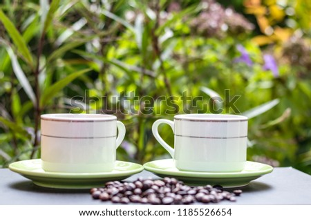 Coffee cups and blurred coffee beans,background is blurred. #1185526654