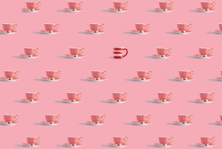 Coffee cups pattern against pastel pink background; one different mug, creative concept, individual, peculiar, unconventional, not fitted, mismatched.