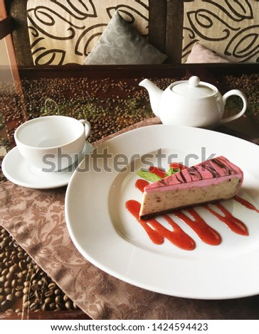 Coffee decorative design, natural elements of glasses table. Brown aroma background. Cafes space for banner. Mock up. White modern style dishes. Desert strawberry jam and cheesecake delicatessen food.