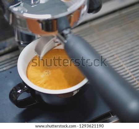 Coffee espresso with espresso machine. Espresso on black scale. #1293621190