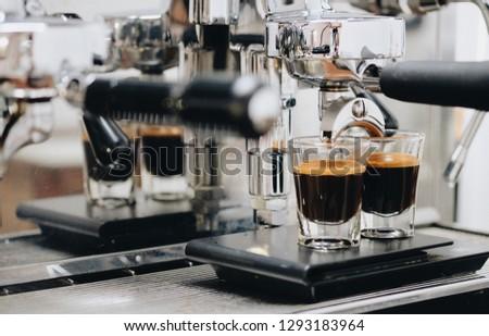 Coffee espresso with espresso machine. Espresso on black scale. Making by professional barista #1293183964