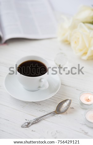 Coffee for breakfast or lunch with decorations, candles and flowers. white roses on the table and cup of coffee #756429121