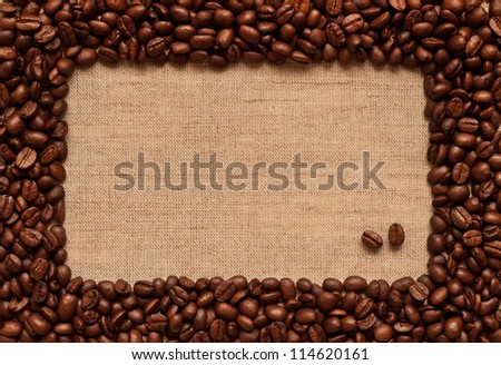 Coffee frame made of coffee beans on burlap texture