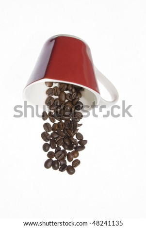 Coffee grains and red coffee cup over white background