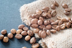 Coffee grains close-up. Beautiful background for the menu. Concept import, export of coffee, cultivation