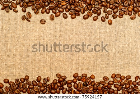 coffee grains on the burlap backgruond with copy space