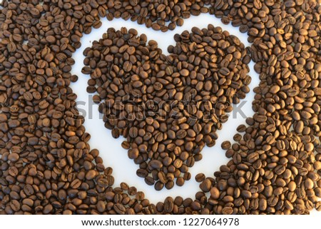 coffee grains on white background #1227064978