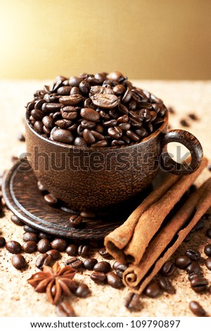 coffee  grains with spices in a wooden cup