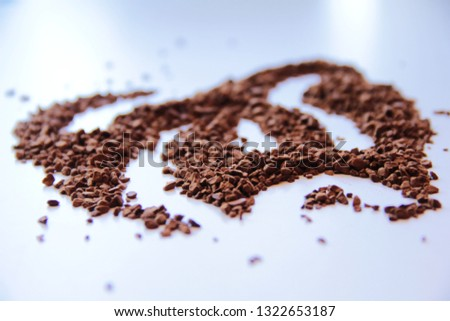 Coffee granules on a light background
