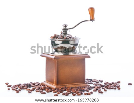 Coffee grinder and coffee beans isolated on white background #163978208