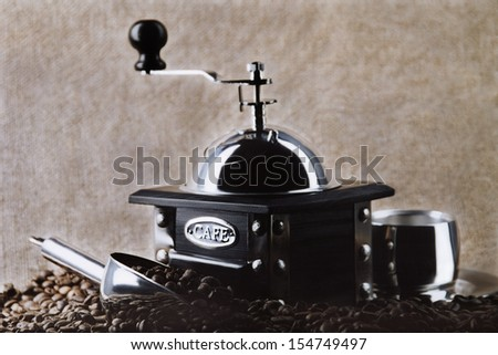 Coffee grinder beans. Still-life with natural coffee