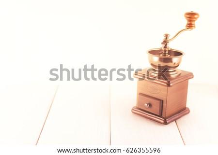 Coffee grinder on white wood floor  #626355596