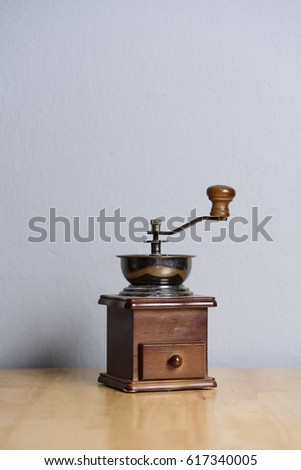 Coffee grinder with beans isolated #617340005
